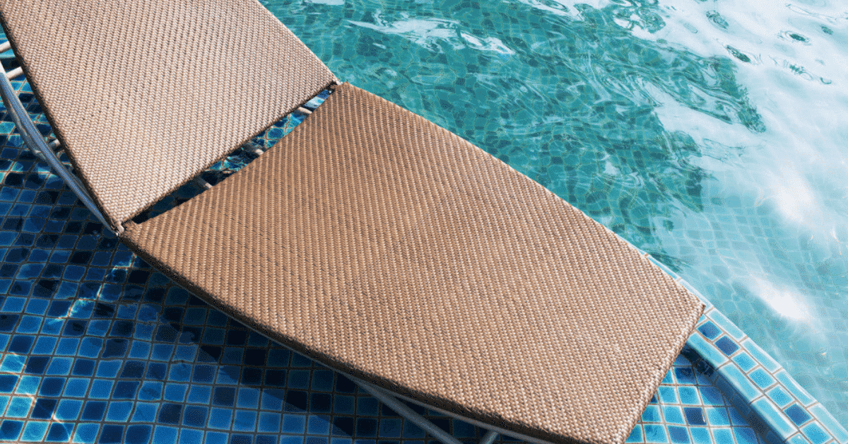 Sun shelf in a swimming pool with a chaise lounge.